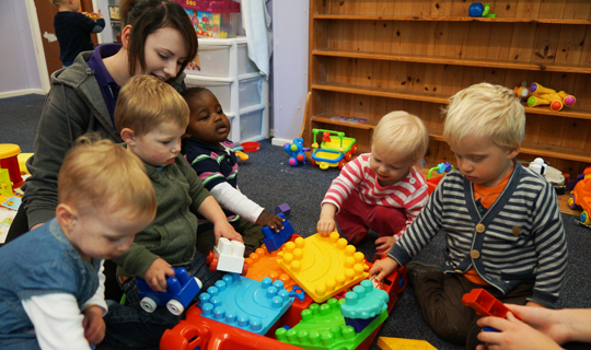 children indoors playing with toys