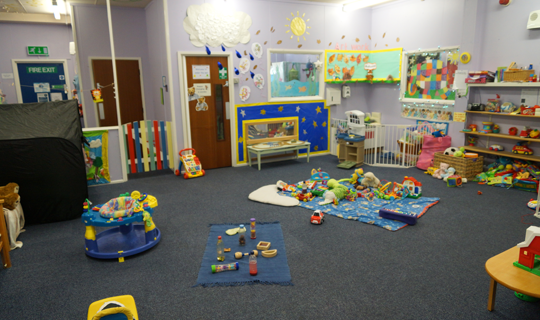 children's play area with a variety of toys