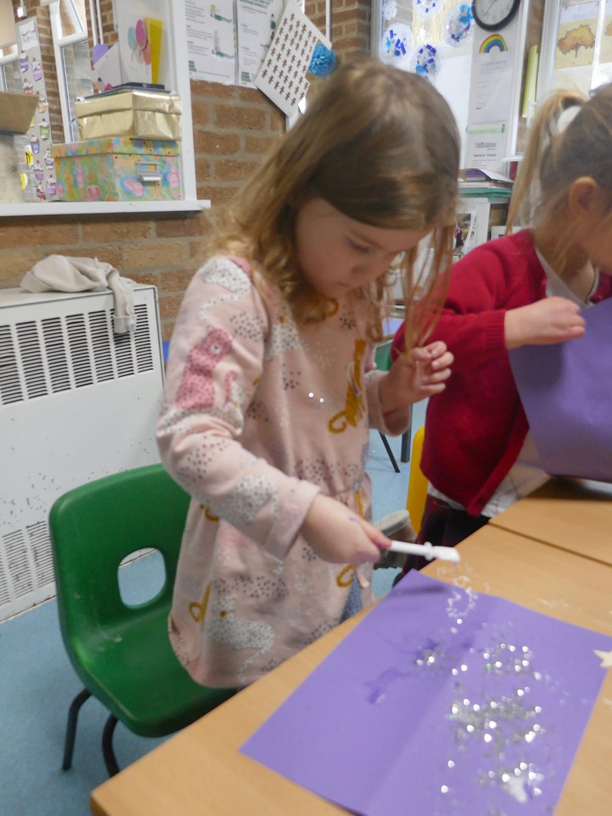 Little girl making a lantern