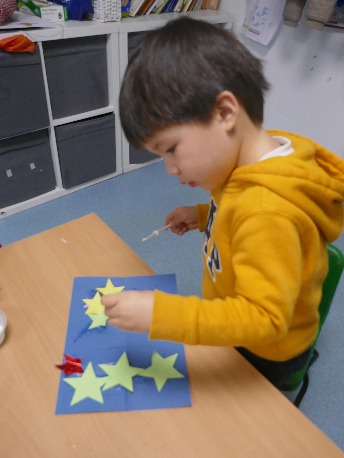 Little boy making a lantern