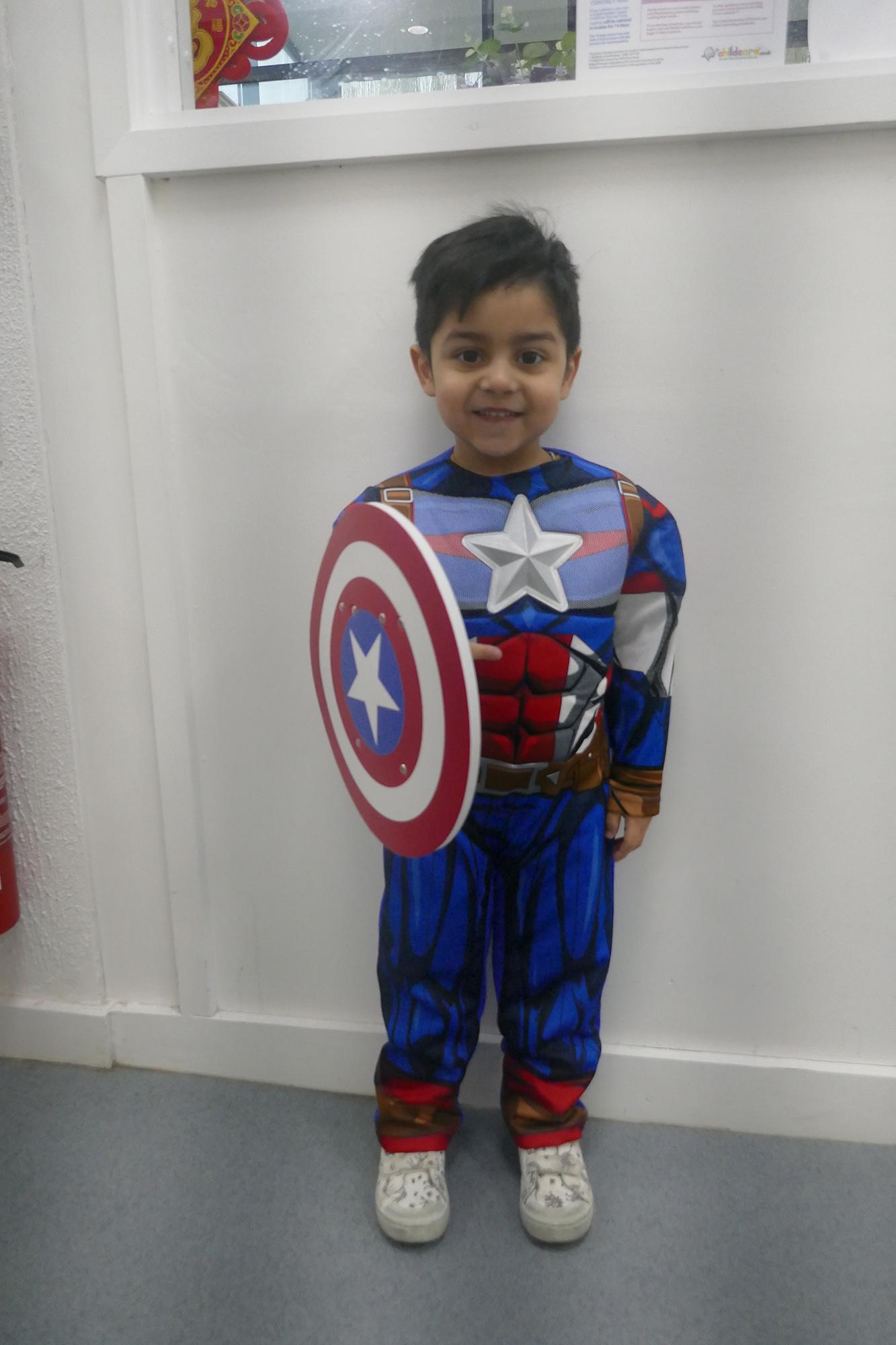 Child dressed as Captain America