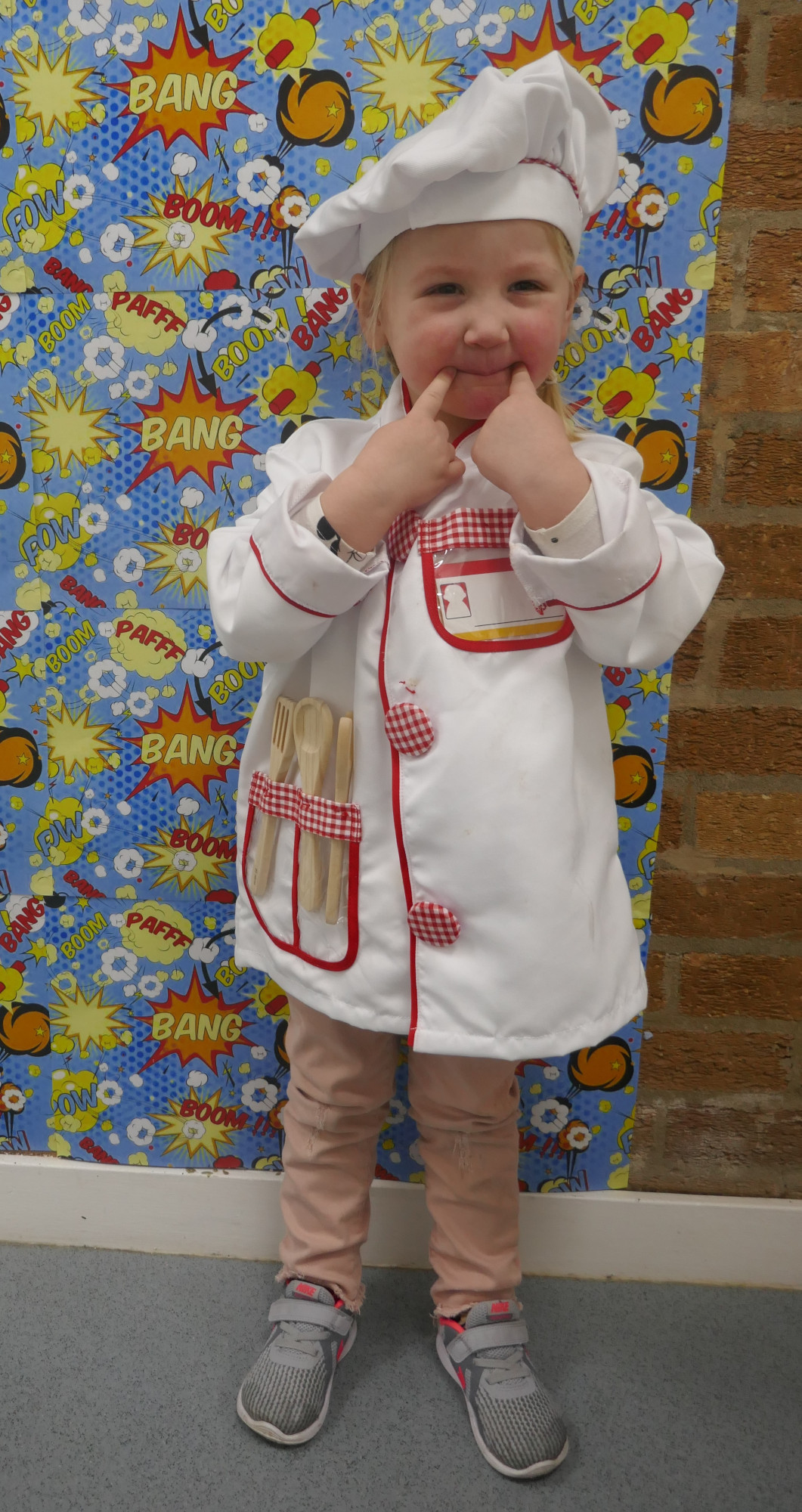 Little girl dressed up as a chef