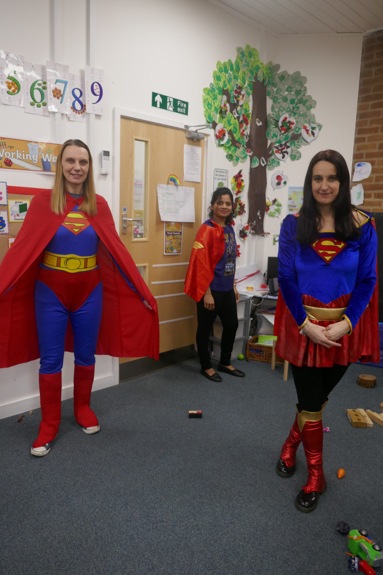 Staff dressed up as super heroes